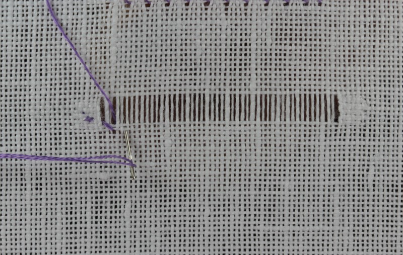 Overcast hem stitch method stage 5 photograph